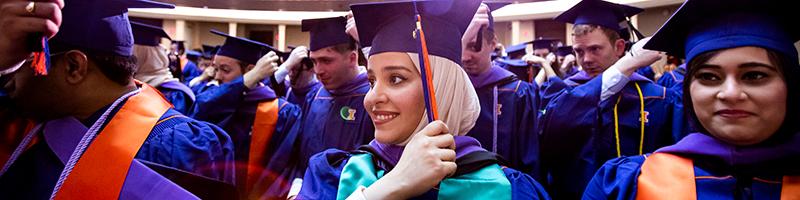 Graduates flip tassel tassel over to the left-hand side of their mortarboards.