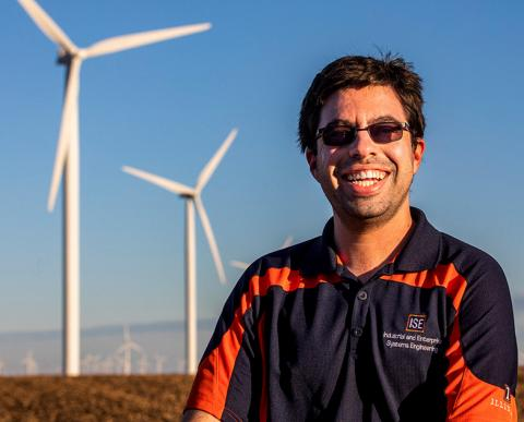 Graduate student Lucas Buccafusca looks for ways to improve the efficiency of wind farms. He had a key insight on a foggy day near a wind farm in central Illinois.