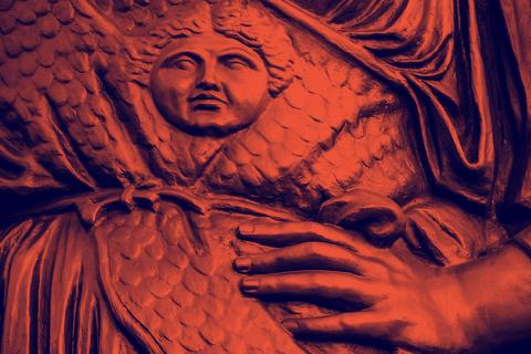 Detail of Alma Mater sculpture showing a hand on hip.