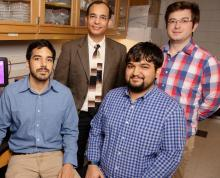 Biochemistry professor Auinash Kalsotra, second from left, and his team, including, from left, graduate students Waqar Arif, Joseph Seimetz and Sushant Bangru, uncovered the molecular underpinnings of liver regeneration.