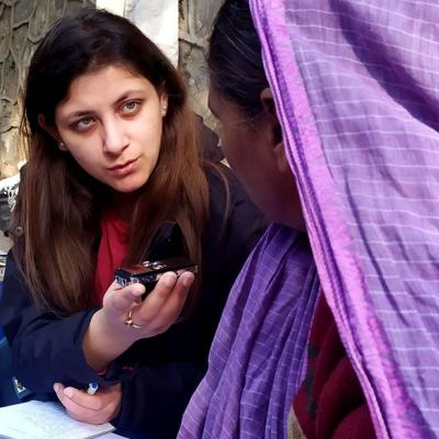 The author interviews vendors in the mahila bazaar in Delhi.