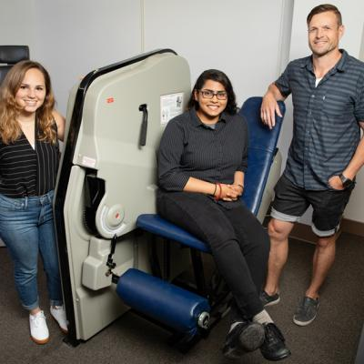 A team including, from left, doctoral student Colleen McKenna, undergraduate student Elizabeth Poozhikunnel and  kinesiology and community health professor Nicholas Burd found that post-workout muscle building and repair is blunted in adults with obesity.