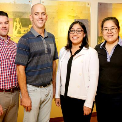 The team included, from left:  graduate student Brett Burrows, kinesiology and community health professor Kenneth Wilund, social work professor Rosalba Hernandez and graduate student Shuo Xu.